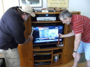 Dave (left, holding crescent wrench) and Brian (right, with hammer) install my new TV